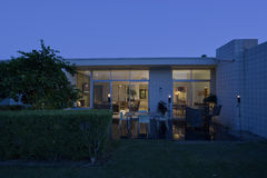 Exterior Of Modern House At Dusk Stock Images