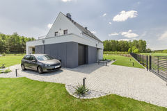 Exterior of modern house. Exterior of small modern house with parked car Royalty Free Stock Image
