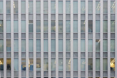 Exterior of a modern office building with repetitive pattern of Royalty Free Stock Images
