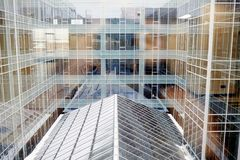New building. Exterior of modern office center and its reflection in glassy walls Stock Images
