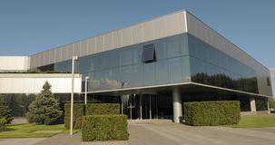 Exterior of a large modern factory or factory, industrial exterior, modern office or commercial center