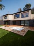 Exterior of a modern villa, veranda with bathtub Royalty Free Stock Photos