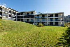 Exterior modern white condominium building with lots of lawn,. Nobody inside royalty free stock image