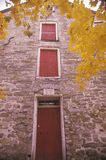 Exterior of Moravian Grist Mill in Autumn, New Jersey Royalty Free Stock Photo