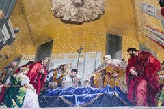 Detailed close up of the body of St. Mark`s mosaic on exterior of St. Mark`s Basilica in Venice. Exterior mosaic detail of St. Mark`s body being transferred to Royalty Free Stock Photography