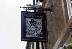 The exterior mount pub sign outside The Friar Penketh public hou. Se part of the Wetherspoon chain of pubs in Warrington Chesahire May 2018 Royalty Free Stock Image