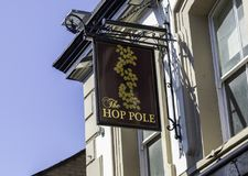 An exterior mounted pub sign for the pub The Hop Pole Warrington. Cheshire May 2018 Royalty Free Stock Image