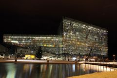 Iceland Travel. An exterior night view of Harpa, Reykjavik concert hall and conference center is seen in Reykjavik, Iceland Stock Photography