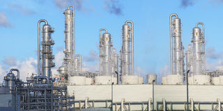 Exterior of oil refinery chimney tube building  in heavy petrole Royalty Free Stock Image