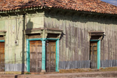 Exterior of old building. Exterior of an old, weather beaten building with faded siding and tile roof Royalty Free Stock Photo
