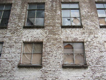 Exterior of old building. Old building with broken windows. Stock Images