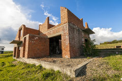Exterior of an old building under construction. Orange brick wal Stock Photo