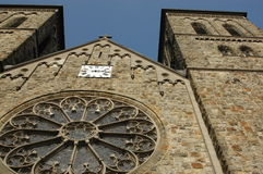 Exterior of old church. Exterior of an old stone church with decorative stained glass window Royalty Free Stock Photos