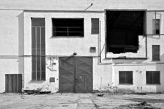 Exterior of old factory. Black and white exterior of old factory building with hole in the wall royalty free stock photos