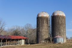 Exterior of old grain silos by modern animal stalls with solar panels, winter. Horizontal aspect royalty free stock photos