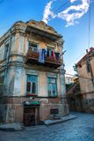 Exterior of an old house with wood balcony in the old town of Tbilisi, Georgia. Tbilisi, Georgia - 8 October 2016: Exterior of an old house with wood balcony in Stock Image