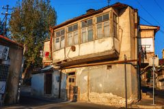 Exterior of an old house with wood balcony in the old town of Tbilisi, Georgia. Tbilisi, Georgia - 8 October 2016: Exterior of an old house with wood balcony in Royalty Free Stock Photo