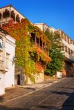 Exterior of an old house with wood balcony in the old town of Tbilisi, Georgia. Tbilisi, Georgia - 8 October 2016: Exterior of an old house with wood balcony in Stock Photos
