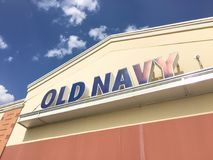 Exterior of Old Navy clothing and accessories retailing company. LEWISVILLE, TX, USA-JUL 1, 2018:Close-up logo facade exterior of Old Navy chain store. Clothing Stock Image