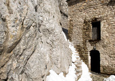 Exterior of an old orthodox church inside a rock Stock Photos