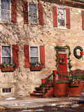 Exterior of old stone house. An exterior view of an old stone house decorated for Christmas Royalty Free Stock Photography