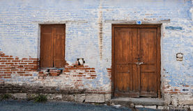 Exterior of an old village house with closed vitnage door and wi Royalty Free Stock Image