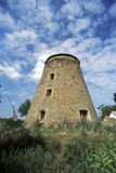 Exterior of old windmill. Building in countryside under cloudscape royalty free stock image