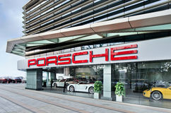 Exterior of a Porsche dealer, Wenzhou, China. WENZHOU-CHINA-NOV. 19, 2014. Porsche dealer in Whenzou. US as Porsche`s largest single market might end in 2015 stock images