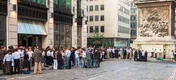 Exterior of pub in the City of London with lots of people drinki Royalty Free Stock Image