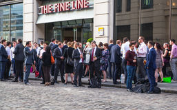 Exterior of pub in the City of London with lots of people drinking and socialising after work. Stock Photo