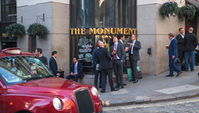 Exterior of pub in the City of London with lots of people drinking and socialising after work. LONDON, UK - APRIL15, 2015: Exterior of pub in the City of London Stock Photo