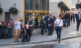 Exterior of pub in the City of London with lots of people drinking and socialising after work. Stock Image