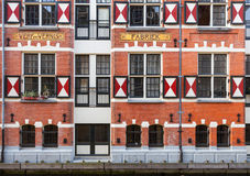 Exterior of quaint houses along a canal in Amsterdam Stock Photos