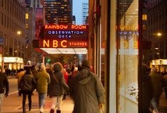 Exterior of RAINBOW ROOM NBC Studios in New York City at night with lighted sign stock photos