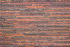 Exterior Red Brick Wall. The texture of the brickwork with different shades of brick Royalty Free Stock Photos