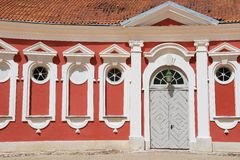 Exterior of the red painted stables building next to Rundale palace in Pilsrundale, Latvia. Stock Images