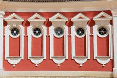 Exterior of the red painted stables building windows next to Rundale palace in Pilsrundale, Latvia. Stock Photo