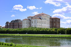Exterior of Reggia di Venaria palace near Turin, Italy. Exterior of Reggia di Venaria palace, gardens and pond, near Turin, Italy Royalty Free Stock Image