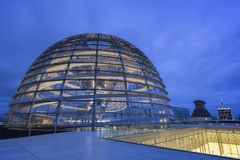 Exterior of the Reichstag dome in Berlin at dusk stock photo