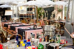 Rome, Italy. November 2017. Tables laid and decorated with delicious embroidered umbrellas. Table with alcoholic drinks in the for. Exterior of a restaurant Stock Images