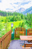 Exterior restaurant and green alpine meadows Stock Image