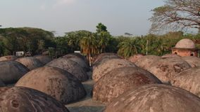 Exterior of the roof domes of the Shat Gombuj Mosque in Bagerhat, Bangladesh. stock video footage