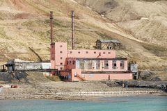 Exterior of the ruined building at the abandoned Russian arctic settlement Pyramiden, Norway. Stock Image