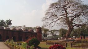 Exterior of the Shat Gombuj Mosque in Bagerhat, Bangladesh. stock footage