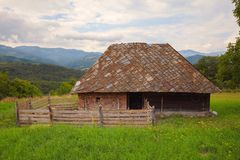 Old Village House for Sheep. Exterior of a sheep house, during summer day stock photography