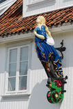 Exterior of the ship  figurehead attached to the facade of a house in Frogn, Norway. Royalty Free Stock Photos