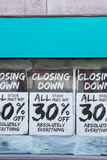 Exterior Of Shop With Closing Down Notice In Window Stock Photo