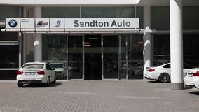 An exterior shot of a BMW dealership stock video footage