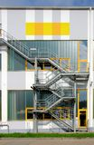 Exterior Staircase. A metal staircase connects the different levels a the factory building in Germany Royalty Free Stock Images
