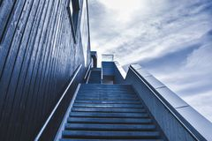 Exterior staircase against blue skies Stock Photo